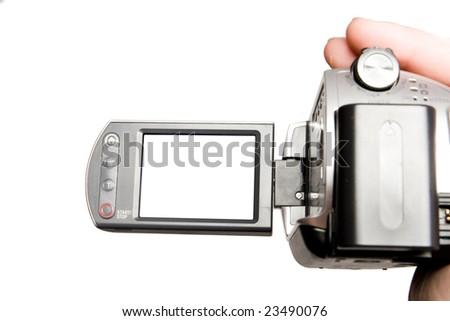 Manual video camera in human hand - stock photo
