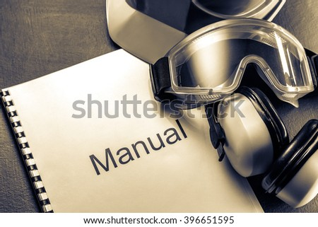 Manual with helmet, goggles and headphones in toning - stock photo