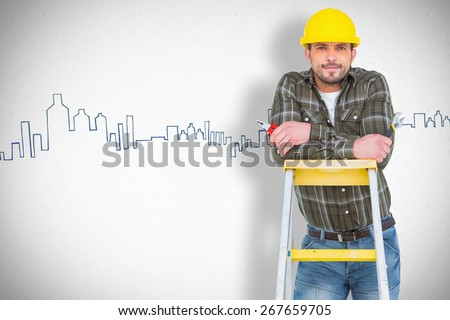 Manual worker against grey - stock photo