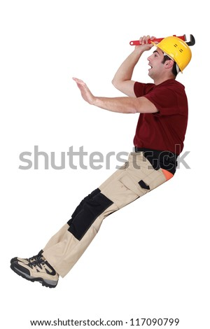 Manual worker falling over - stock photo