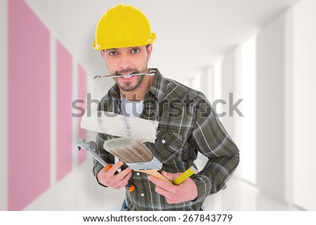 Manual worker holding various tools against modern white and pink room with window