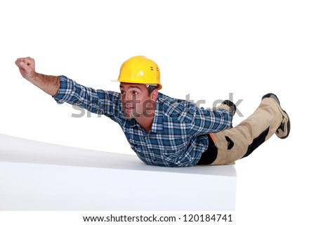 Manual worker in superman pose - stock photo