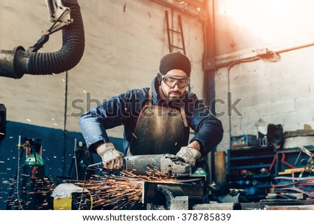 manual worker on a workshop - stock photo