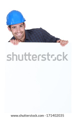 Manual worker stood with advertisement board - stock photo