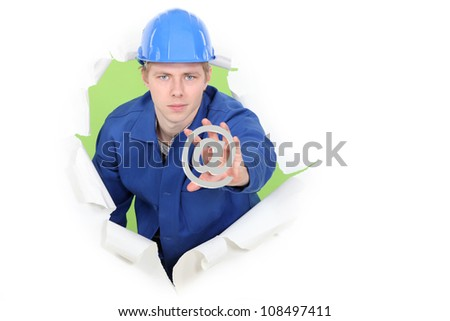 Manual worker with an sign - stock photo