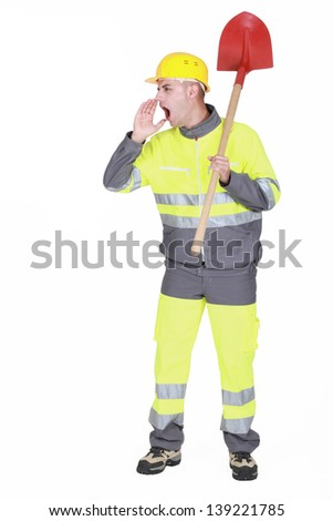 Manual worker with shovel shouting