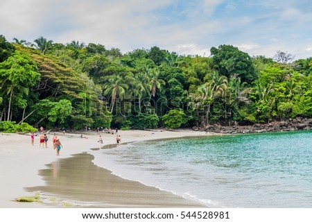 MANUEL ANTONIO, COSTA RICA - MAY 13, 2016: Tourists on a beach in National Park Manuel Antonio, Costa Rica