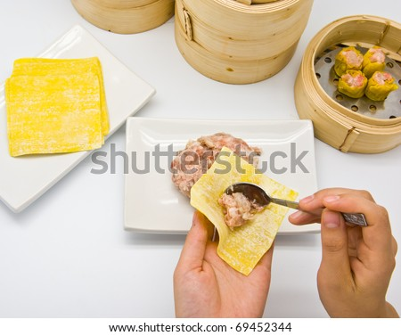Manufacture of dim sum on white background - stock photo