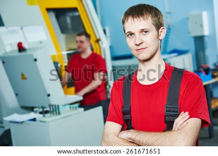manufacture technician worker at factory metal machining shop - stock photo