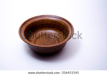 manufactured wooden bowl empty. kitchen utensil