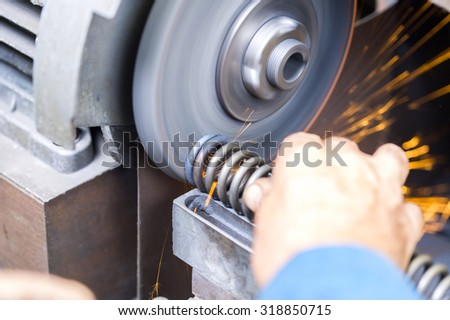 Manufacturing and sharpening of the spring - stock photo