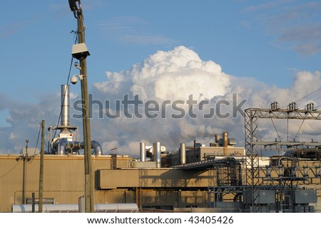 Manufacturing plant and cloud of smoke