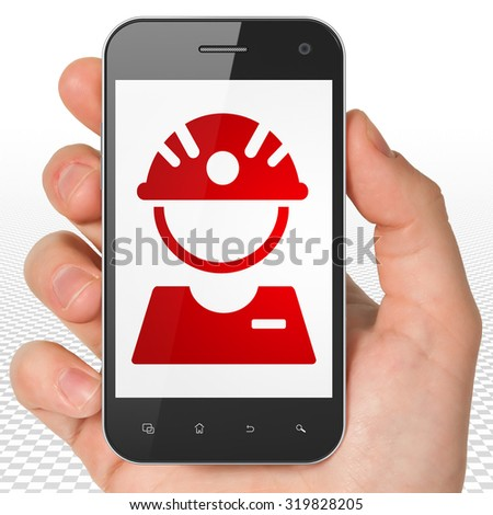 Manufacuring concept: Hand Holding Smartphone with red Factory Worker icon on display - stock photo