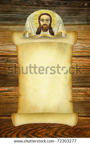 Manuscript for a prayer or an old form to the sacred text in the old Russian style with a Christian image of Jesus Christ. Vintage background on the brown wooden texture. Dark old parchment blank. - stock photo