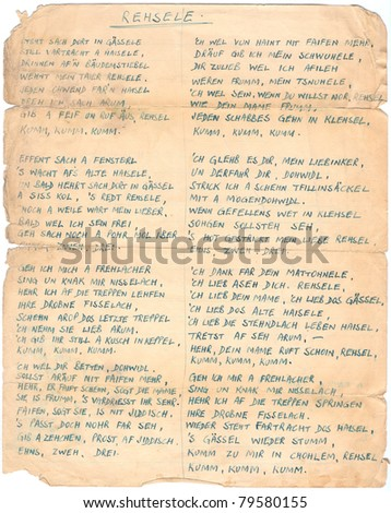 Manuscript fragment of the Jewish folk song written in German in the 30s. Rich stain and paper details. Can be used for background. - stock photo