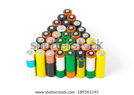 Many AA sized batteries on white - stock photo