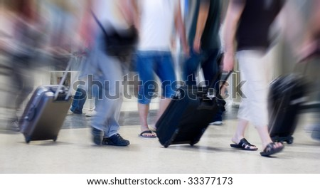Many Airline Passengers Moving in the Airport - stock photo