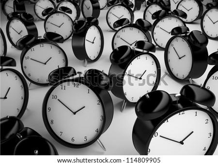 many alarm clock  on a gray background - stock photo