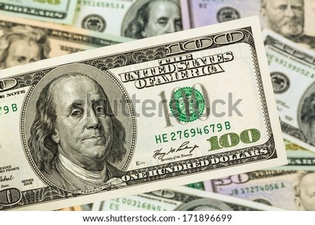 many american dollar bills. symbol photo debts and wealth