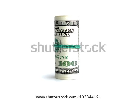 many american dollars in the tube, one hundred - stock photo