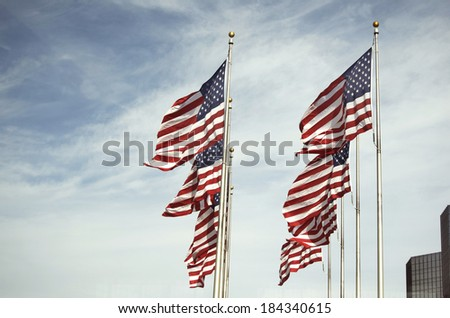 Many American Flags Waving On Poles In Detroit - stock photo