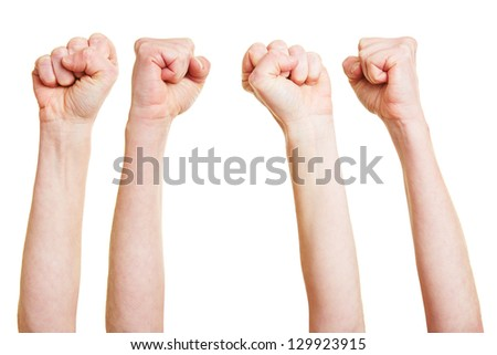Many angry clenched fists reaching into the air - stock photo