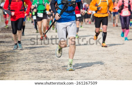 many athletes run in the outdoor race on the road - stock photo