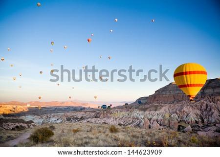 Many balloons over Cappadocia in Turkey - stock photo