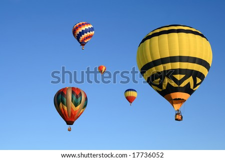 Many beautiful hot air balloons in the clear sky. - stock photo