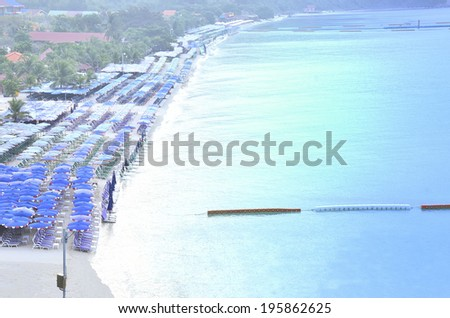 Many benches on long beach for holiday recreation. - stock photo