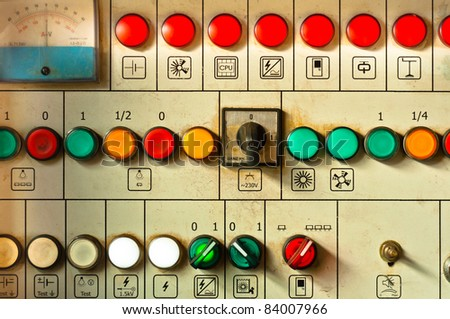 Many big buttons on an industrial board - stock photo