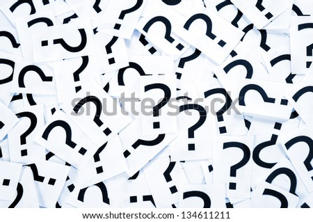 Many black question mark on papers - stock photo