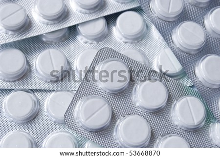 Many blisters with white tablets - stock photo