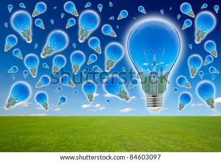 Many blubs on the blue sky. Ecological concept, reflection of nature in lamps. - stock photo