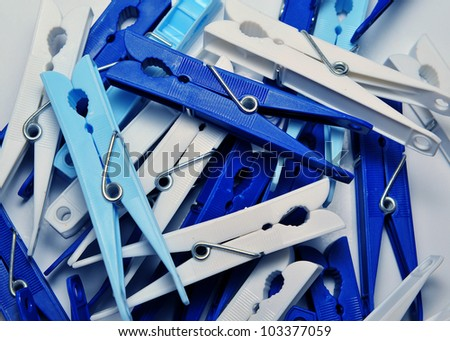 Many blue and white plastic clothes pins - stock photo