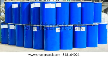 Many blue barrels on a chemical plant - stock photo