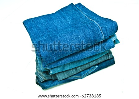 many blue jeans in the bright background