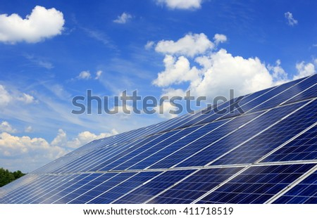 many blue solar panels to generate power - stock photo