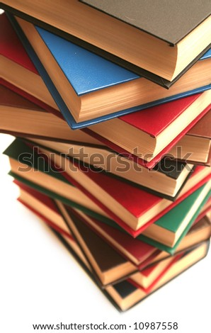 Many books lay on a white background