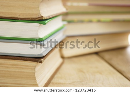 Many books on the wooden table