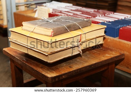 Many books on wooden chair in library - stock photo