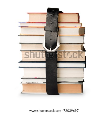 many books pile with black leather belt - stock photo