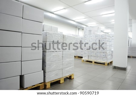Many boxes, interior of modern warehouse - stock photo
