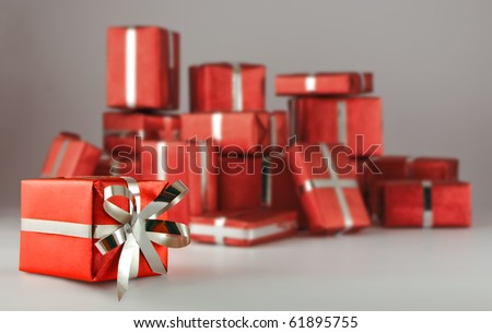 many boxes of gifts on a gray background - stock photo