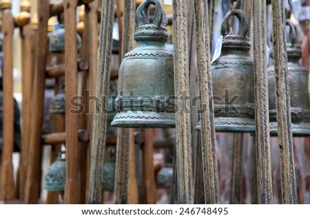 Many brass bell hanging in Buddha temple