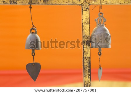 Many brass bell in Thai temple, The Bell Jar resonate in the temple. - stock photo
