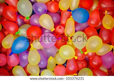 Many bright and colorful water balloons - stock photo