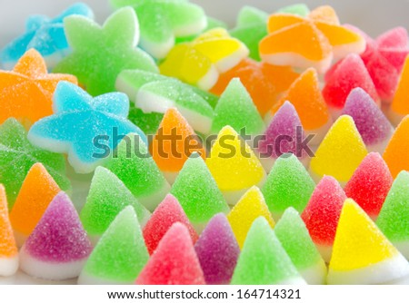 Many bright color jelly candies, sweets with sugar tasty as jujube and lollipops. - stock photo