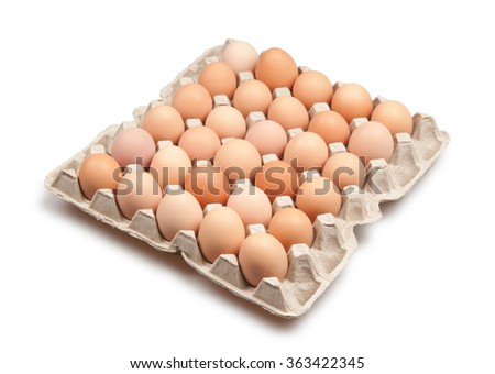 many brown eggs isolated on white - stock photo