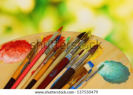 Many brush in paint close-up - stock photo